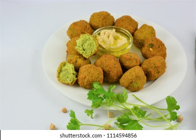 Falafel on a white plate on a white background