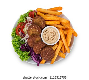Falafel plate with fresh vegetables, hummus and french fries isolated on white background.