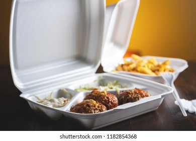 Falafel with vegetables and fries - a take-away dish to eat at the office