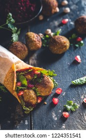 Falafel Wrap with Green and Beet Hummus Sauce