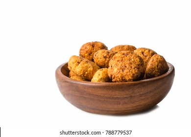 falafels in a wooden bowl isolated on white background.  healthy vegetarian lifestyle.