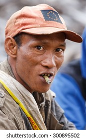 FALAM, MYANMAR - JUNE 17 2015: Local man smoking burmese cigar (cheroot) at the start of the monsoon season in the recently opened to tourists Chin State region of Western Myanmar (Burma)