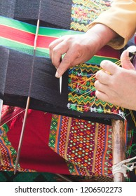 Falam Myanmar on February 20, 2017: lady was embroider fabrics become clothes