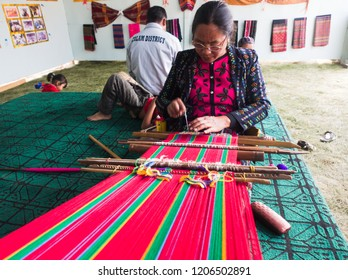 Falam Myanmar on February 20, 2017: a lady was weaving traditional fabrics