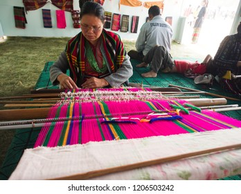 Falam Myanmar on February 20, 2017: a lady was weaving bright fabric colors