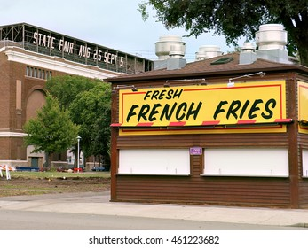 Falcon Heights, Minnesota - July 27, 2016:  A popular French fry concession in front of the grandstand at the Minnesota State Fairgrounds in the weeks leading up to the fair.