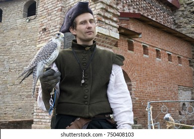 Falconer with a falcon, September 9, 2017, at the Oreshek Fortress Festival, in Russia, the city of Shlisselburg. Military-historical events of the times of the Russo-Swedish war of 1612.