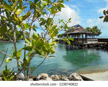 fale (traditional wooden house of local Samoan people) near the sea close to Piula cave pool, tourist attraction on Upolu island, Samoa, South Pacific, Oceania