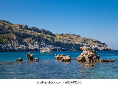 FALIRAKI, RHODES, GREECE - APRIL 23, 2017 ; Anthony Quinn Bay, Rhodes in Faliraki. Beautiful beach on the island of Rhodes. One of the most beautiful bays in the city of Faliraki, Greece.