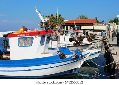 FALIRAKI, RHODES, Greece - June 16, 2019: Fishing boats in the little harbour of Faliraki, a fishing village and vacation destination on the island Rhodes.