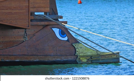 Faliro, Attica / Greece - November 04 2018: Extreme zoom detail photo of ancient Greek warship full scale replica Trireme in port of Flisvos