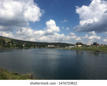 Falkertsee in the Nocky Mountains, Austria – July 27 2019: Beautiful summer day with blue, cloudy sky at the Falkertsee in Austria.