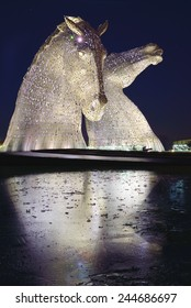 FALKIRK - DECEMBER 28: The Kelpies Horse statues lit up at night created by Glaswegian sculptor Andy Scottt at Falkirk, Scotland on Dec 28th 2014.