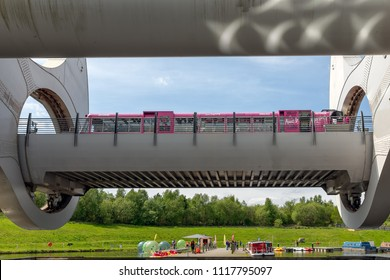 Falkirk, Scotland - May 19, 2018: Launch in Falkirk Wheel, rotating boat lift in Scotland, which connects the Forth and Clyde Canal with the Union Canal.