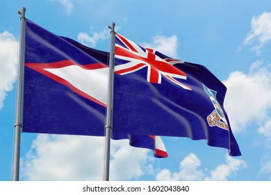 Falkland Islands and American Samoa flags waving in the wind against white cloudy blue sky together. Diplomacy concept, international relations.