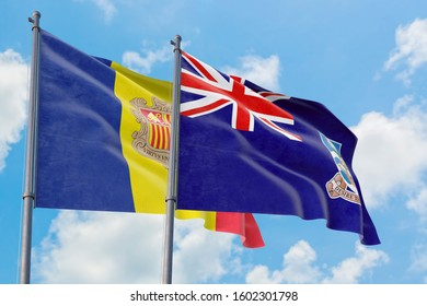 Falkland Islands and Andorra flags waving in the wind against white cloudy blue sky together. Diplomacy concept, international relations.