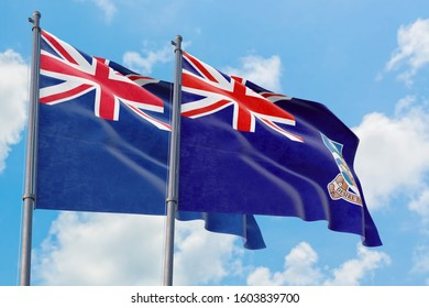 Falkland Islands and Anguilla flags waving in the wind against white cloudy blue sky together. Diplomacy concept, international relations.