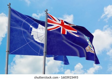 Falkland Islands and Antarctica flags waving in the wind against white cloudy blue sky together. Diplomacy concept, international relations.