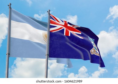 Falkland Islands and Argentina flags waving in the wind against white cloudy blue sky together. Diplomacy concept, international relations.