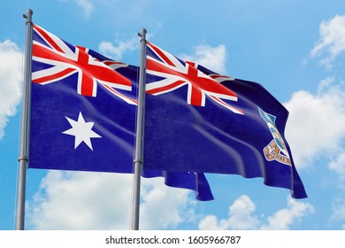 Falkland Islands and Australia flags waving in the wind against white cloudy blue sky together. Diplomacy concept, international relations.