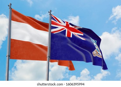 Falkland Islands and Austria flags waving in the wind against white cloudy blue sky together. Diplomacy concept, international relations.