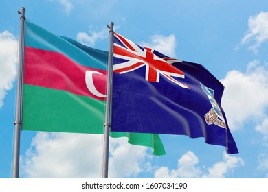 Falkland Islands and Azerbaijan flags waving in the wind against white cloudy blue sky together. Diplomacy concept, international relations.
