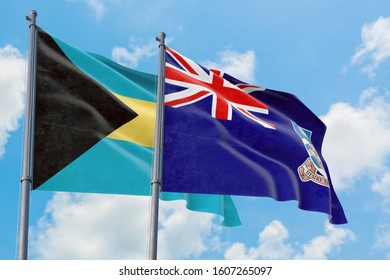 Falkland Islands and Bahamas flags waving in the wind against white cloudy blue sky together. Diplomacy concept, international relations.