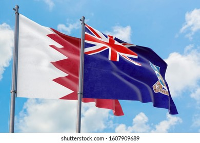 Falkland Islands and Bahrain flags waving in the wind against white cloudy blue sky together. Diplomacy concept, international relations.