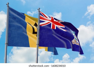 Falkland Islands and Barbados flags waving in the wind against white cloudy blue sky together. Diplomacy concept, international relations.
