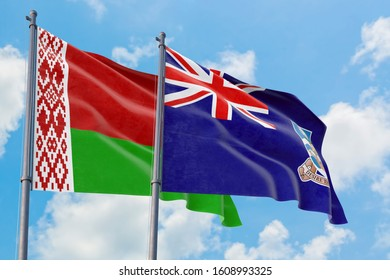 Falkland Islands and Belarus flags waving in the wind against white cloudy blue sky together. Diplomacy concept, international relations.