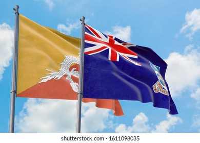 Falkland Islands and Bhutan flags waving in the wind against white cloudy blue sky together. Diplomacy concept, international relations.