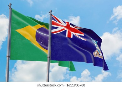 Falkland Islands and Brazil flags waving in the wind against white cloudy blue sky together. Diplomacy concept, international relations.