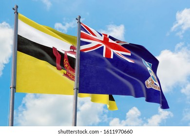 Falkland Islands and Brunei flags waving in the wind against white cloudy blue sky together. Diplomacy concept, international relations.