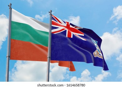 Falkland Islands and Bulgaria flags waving in the wind against white cloudy blue sky together. Diplomacy concept, international relations.
