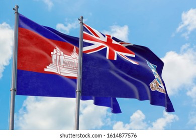 Falkland Islands and Cambodia flags waving in the wind against white cloudy blue sky together. Diplomacy concept, international relations.