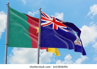 Falkland Islands and Cameroon flags waving in the wind against white cloudy blue sky together. Diplomacy concept, international relations.