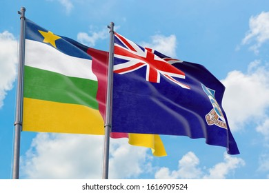 Falkland Islands and Central African Republic flags waving in the wind against white cloudy blue sky together. Diplomacy concept, international relations.