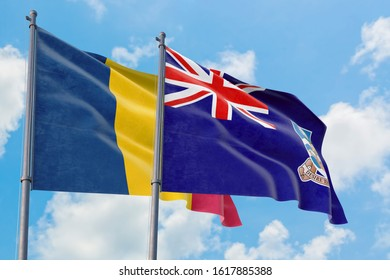 Falkland Islands and Chad flags waving in the wind against white cloudy blue sky together. Diplomacy concept, international relations.