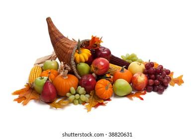 A Fall arrangement in a cornucopia on a white background
