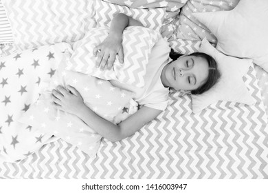 Fall asleep as fast as possible. Fall asleep faster and sleep better. Healthy sleep. Sweet dreams. Girl child lay bed pillow and blanket bedroom top view. Lullaby concept. Ways to fall asleep faster.