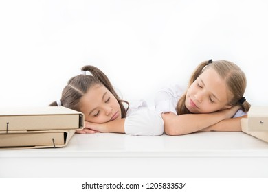 Fall asleep on lesson. Girls fall asleep while work school project white background. Schoolgirls tired of studying. Kids girls sleepy faces lean on desk and sleep. Tired pupils drowsy faces sleeping.