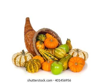 A fall or autumn cornucopia on white background.  Harvest horn of plenty.
