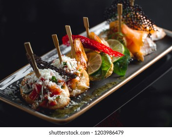 Fall background of food. Amazing Lunch. Party food.Served on plate. Catering service. Black interior restaurant table with food.