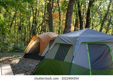 fall camping with two tents on campsite in early morning light