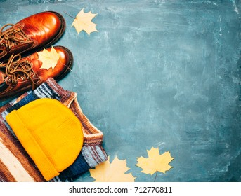 Fall clothing,sweater, hat, brown shoes, leaves accessories. Autumn background.