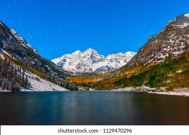 fall color at Maroon lake at night after snow in Aspen, Colorado.