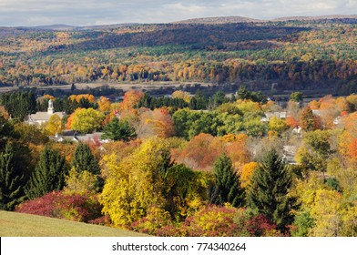 Fall colors around Walpole, New Hampshire, a small New England town in the Connecticut River Valley. Vermont Green Mountains on background.