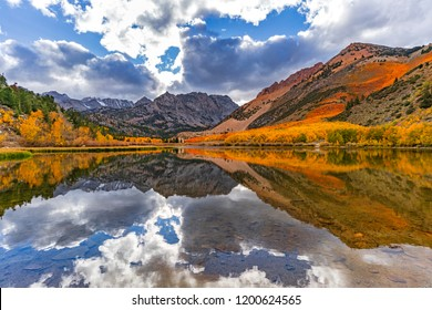 Fall colors are in full bloom at North lake in Bishop Creek Canyon high up in the Eastern Sierra as an early storm is clearing out