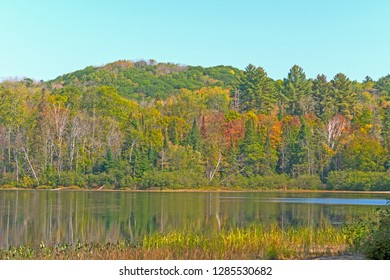 Fall Colors on a Forested Arrowhead Lake in Arrowhead Provincial Park in Ontario, Canada