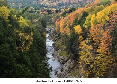 Fall colors on the Ottauquechee river at Quechee Gorge Vermont